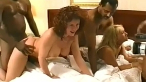 Busty playing with black dick stranger in the bed