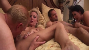 Hot Sophie Dee feels up to group sex