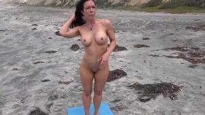 Nude & busty mature yoga outdoors