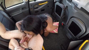 Cumshot in a taxi next to brunette