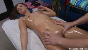 Brunette Lily Carter hard blowjobs on the table