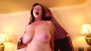 Saggy tits granny in glasses POV getting a facial
