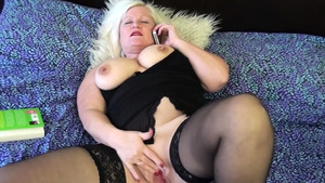 Blonde haired Lacey Starr in sexy stockings gagging